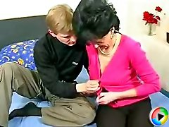 Sweet lad gets a taste of his first MILF by licking her pussy and fucking her hard